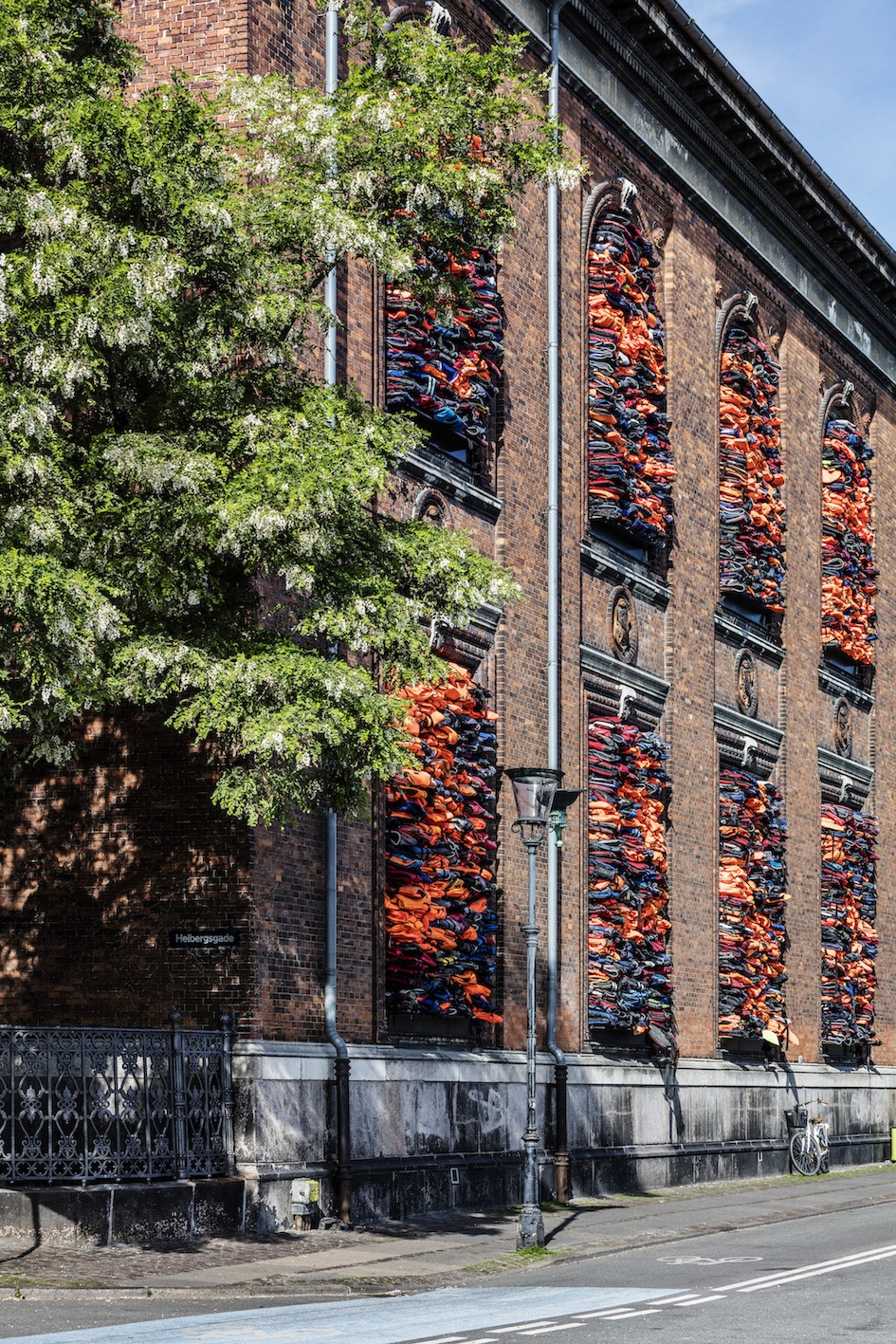 "Ai Weiwei, ""Soleil Levant"", 2017. Installation view, Kunsthal Charlottenborg, 2017. Life jackets in front of windows of facade. Courtesy of the artist. Photo by Anders Sune Berg"